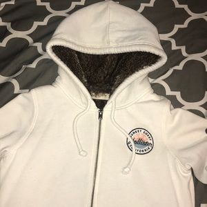 Hollister zip up sweater with faux fur inside.